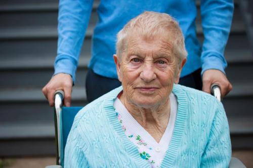 older woman sitting on wheel chair